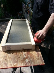 Use the sander to vibrate out the air-very important otherwise you will get a very rough looking bench underneath