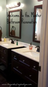 Master bathroom renovation with The Home Depot vanities, Pergo flooring, Pfister faucets, and shower