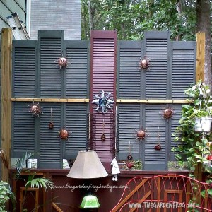 Using wood shutters to create privacy on the deck
