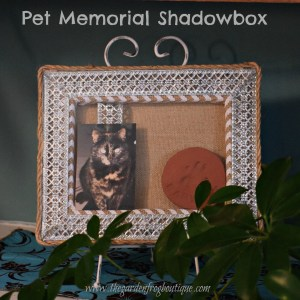 Create a pet memorial shadowbox from a stretchd burlap canvas