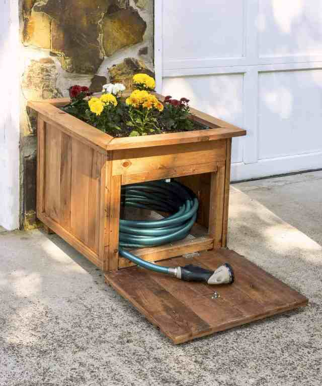 Wood hose caddy with planter open e1466459595472