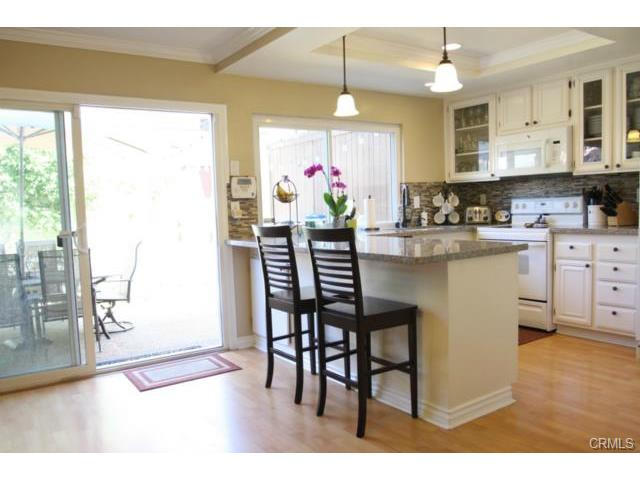 Kitchen - breakfast bar - open to dining area and private patio