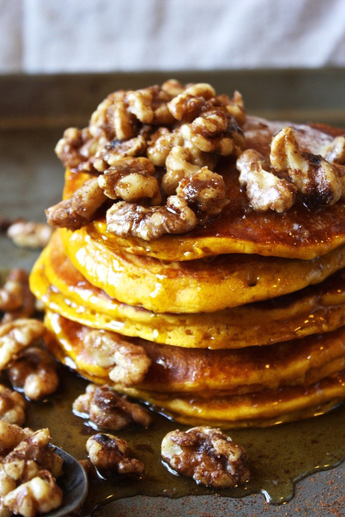 Pumpkin, Maple Pancakes with Brown Sugar Spiced Walnuts - the combination of fluffy, sweet, pumpkin-y pancakes and crunchy spiced walnuts...it's heaven! The perfect dish for fall :) -- TheGarlicDiaries.com