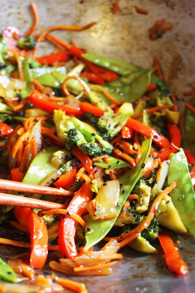 15 Minute Veggie Stir Fry - This dinner comes together in the blink of an eye but has the most amazing flavor! No one will ever guess that it only took you 15 minutes to make -- TheGarlicDiaries.com