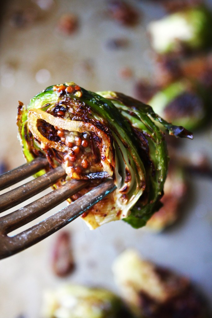 Roasted Brussels Sprouts with Mustard Sauce and Charred Shallots [21 Day Fix] - These brussels sprouts will literally blow your mind they are so delicious. They are a MUST HAVE side dish! Perfect for Thanksgiving (or any occasion, really) #21dayfix #glutenfree TheGarlicDiaries.com