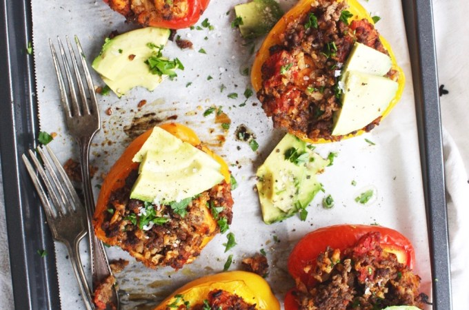 Whole 30 Stuffed Peppers - These stuffed peppers are hearty and full of flavor! Cauliflower rice instead of regular rice bulks up the filling and adds extra veggies - so good! TheGarlicDiaries.com