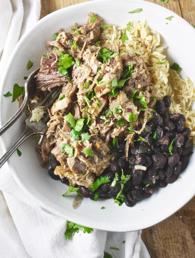 Instant Pot Mojo Pork! This delicious Instant Pot recipe is easy to make and creates SUCH delicious, flavorful, juicy pork! I love to serve mine with rice and beans for a complete meal. It's a fave! TheGarlicDiaries.com