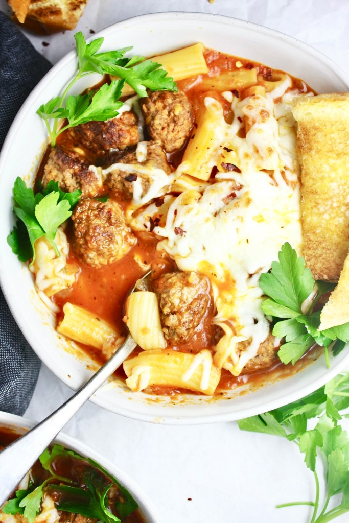 Rigatoni Meatball Soup - Super simple homemade meatballs simmered in a delicious tomato broth for a quick 20 mins! Stir in rigatoni at the end for a hearty, deliciously flavorful dinner! TheGarlicDiaries.com