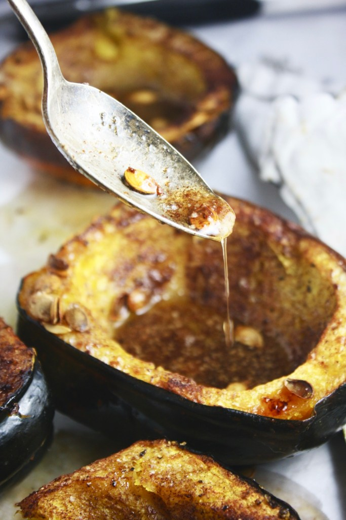 Brown Sugar Butter Roasted Acorn Squash - The ultimate fall veggie prep right here, people. It's salty and sweet, it's tender and crunchy from the roasted seeds - SO unreal good! TheGarlicDiaries.com