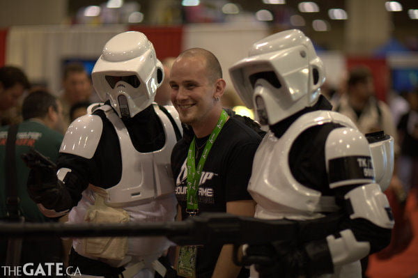 A fan poses with storm troopers
