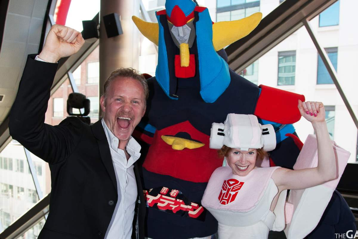 Director Morgan Spurlock with two costumed fans