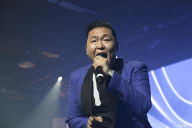 Psy sings for the cameras