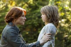 Bryce Dallas Howard as Grace and Oakes Fegley as Pete