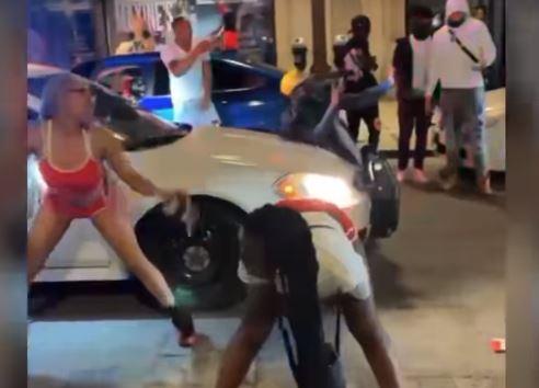 St. Louis: Street Mob Stops Police Car — Twerks in the Street — Dances on Its Roof (VIDEO)