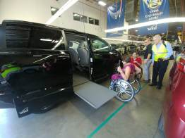Kirstina demonstrated the manually sliding ramp on their more economical, Caravan-based models.
