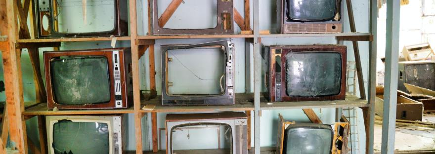 wall of old televisions