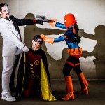 Two-Face and Deathstroke fighting over Robin