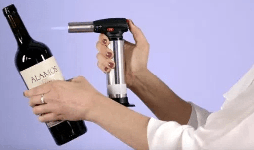 Use flamethrower to open a Wine Bottle without a Corkscrew