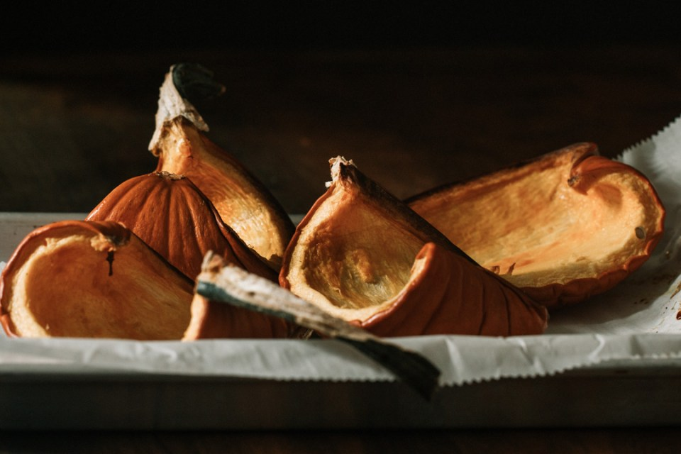 roasted pumpkin pieces in a pan