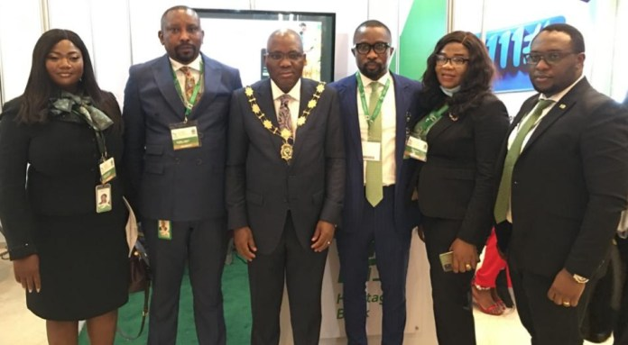 """L-R: Preye Ojeme, Heritage Bank's Experience Centre Manager, Maitama, Abuja; Daniel Oniko Regional Head Abuja 1; Dr. Bayo Olugbemi, President/Chairman of Council, Chartered Institute of Bankers of Nigeria; Isaiah Ediae, Experience Centre Manager, Algiers Wuse; Dab Okosun, staff of Federal Mortgage Bank of Nigeria and Efehi Cole, Experience Centre Manager, Garki, during the 14th Annual Banking and Finance Conference of Chartered Institute of Bankers of Nigeria (CIBN) with a theme: """"Economic Recovery, Inclusion & Transformation: The Role of Banking and Finance,"""" held in Abuja."""