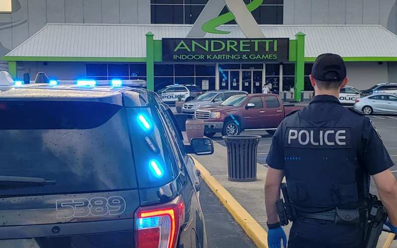 Police search for clues in Andretti parking lot shooting