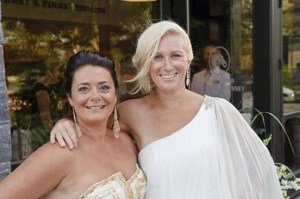 Beth Alexander and Heather Straughters, co-chairs of the White Party benefit for Saratoga Bridges in front of Fasig-Tipton. Photo By Eric Jenks 7/20/13