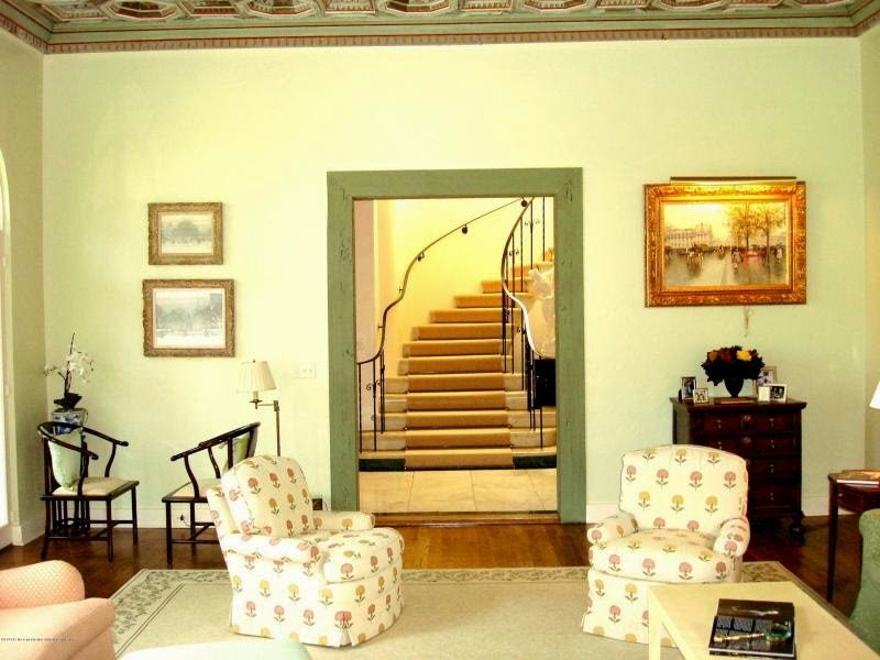 Spectacular  ceilings in the living and dining rooms pecky cypress doors and gracious staircase I am also in love with the murals which are so Palm Beach Chic