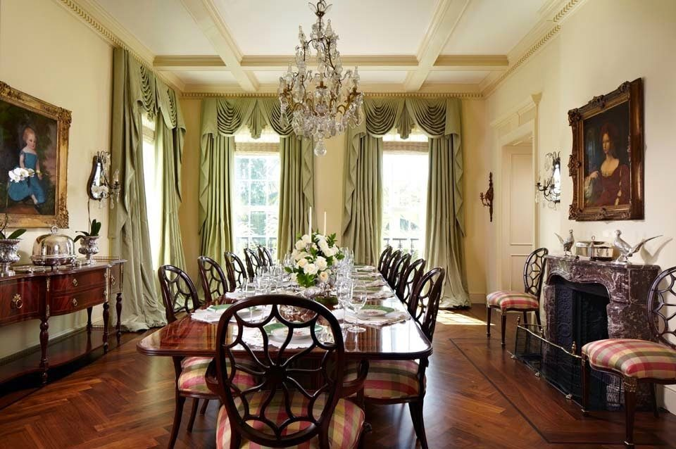 Cute Herringbone floors provide an engaging rhythm while plaid silk taffeta draperies add softness and color The oversized chandelier anchors the room and is