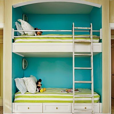 Cute The children us room acmodates as many as six people with two queen beds and a set of railroad style bunk beds built into the wall