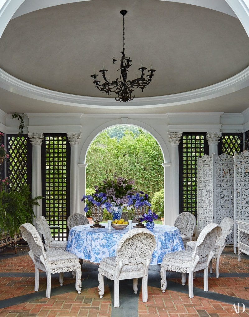 15ee4499ecd A D. Porthault tablecloth dresses the table in the poolhouse. Vintage  chairs by Tony Duquette.