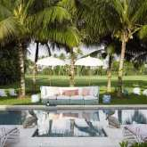 Windwhistle-lyford-cay-bahamas-nassau-amanda-lindroth-island-hopping-designs-poolside-chic-umbrellas-palm-trees