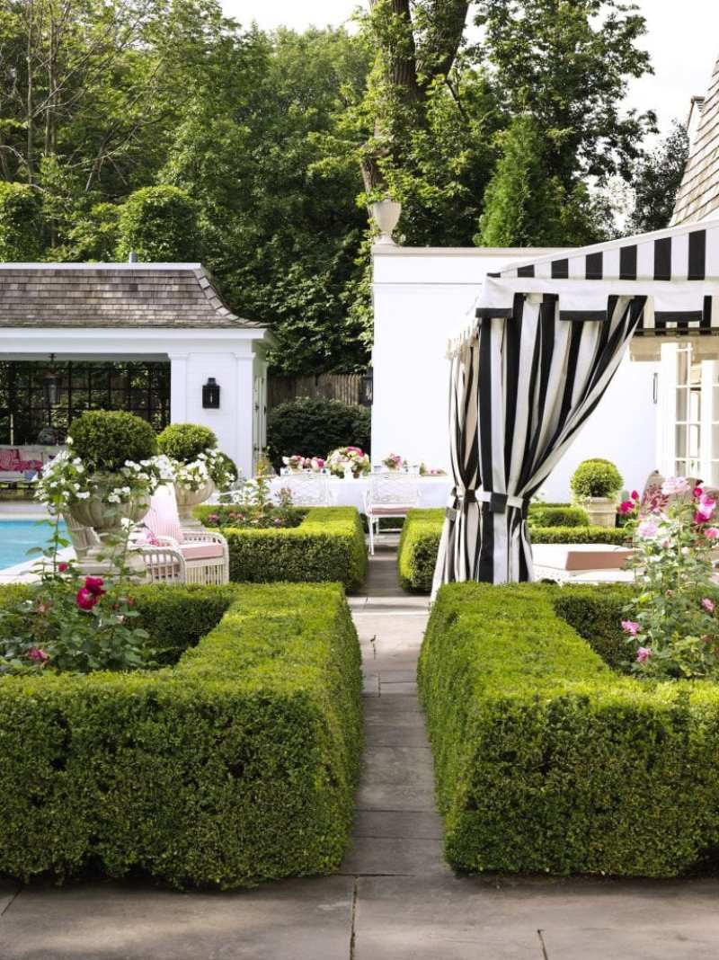 custom-awning-black-white-stripes-hollywood-regency-rose-garden-boxwoods-roses
