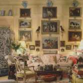 mario-buatta-architectural-digest-bows-dog-art-gallery-wall-blue-white-chinese-porcelain-living-room