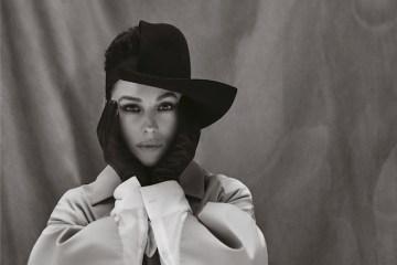 Monica Bellucci- Hat YOHJI YAMAMOTO Gloves STOCKER Jacket LUTZ HUELLE Dress ANDREAS KRONTHALER FOR VIVIENNE WESTWOOD