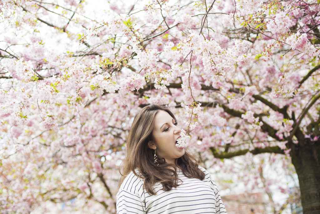 Eating cherry blossoms, Blossoms and Stripes, photo by Brandie Raasch Paris Ever After