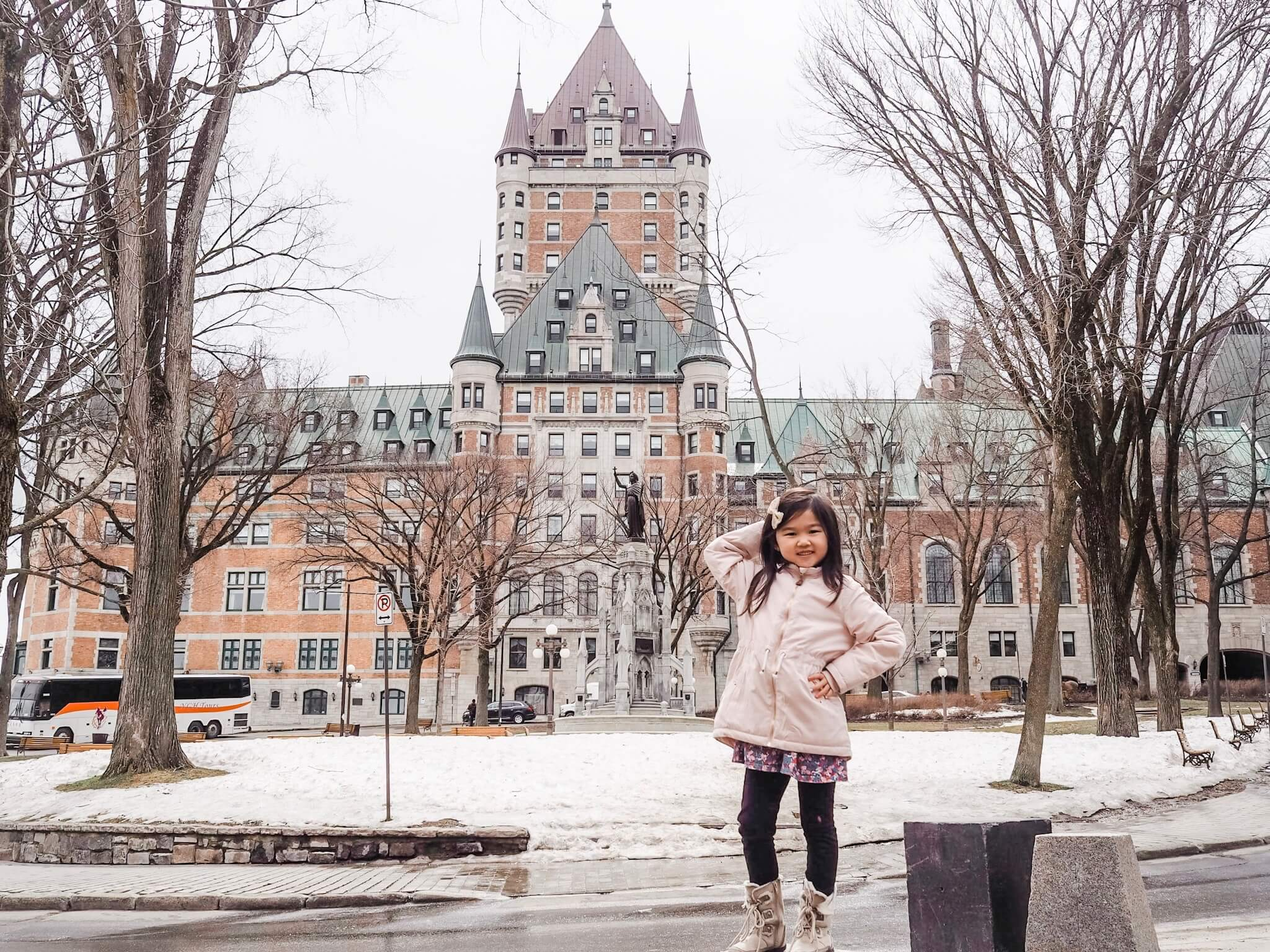 Sophie posing in front of the Fairmont Le Chateau Frontenac - Quebec City, Canada