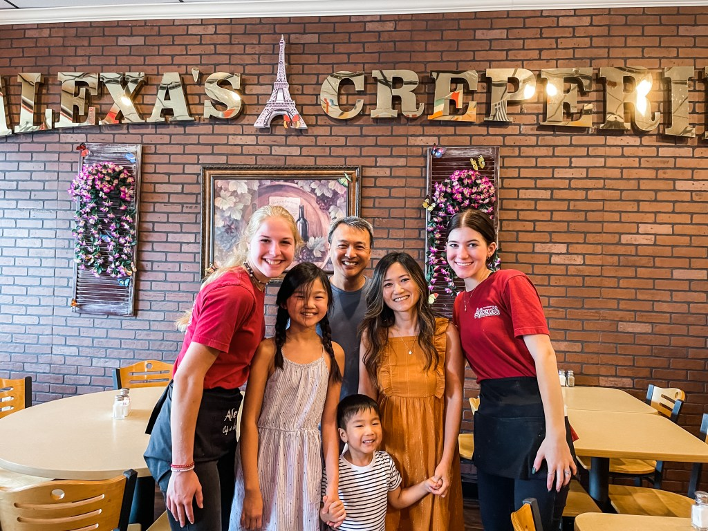Wait staff of Alexa's Creperie taking a photo with The Globetrotting Family
