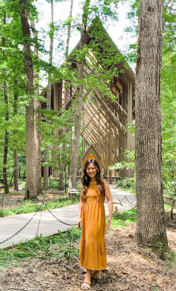 Woman standing in front of Anthony Chapel at Garvan Gardens in Arkansas