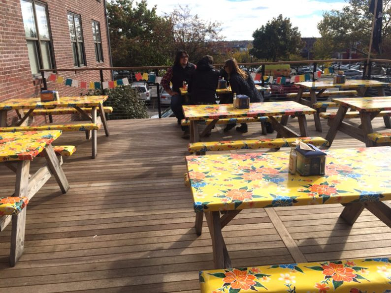 The outdoor dining deck is attractive and will be great for dining when warm weather returns