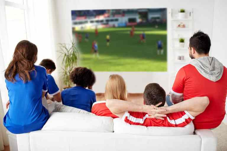 Family watching a soccer