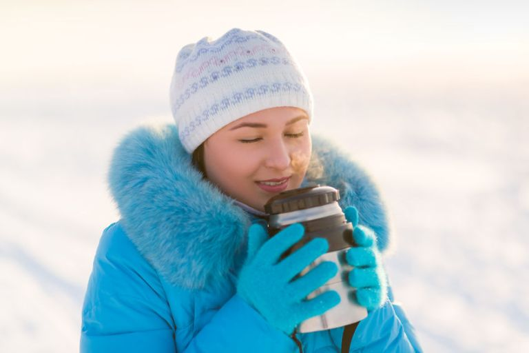 winter photo. girl with thermos