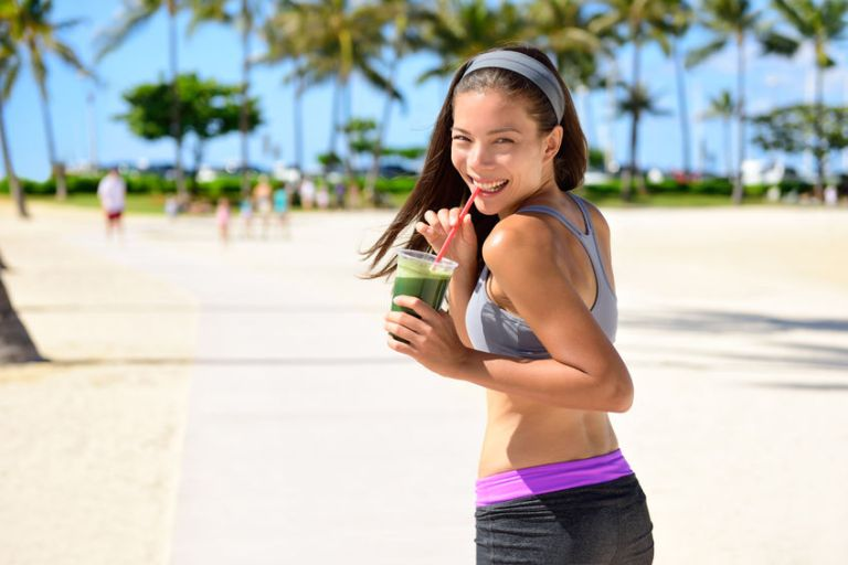 Girl drinking a green juice