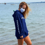 Navy Blue Shipwreck'd hoodie with lat and long coordinates on sleeve
