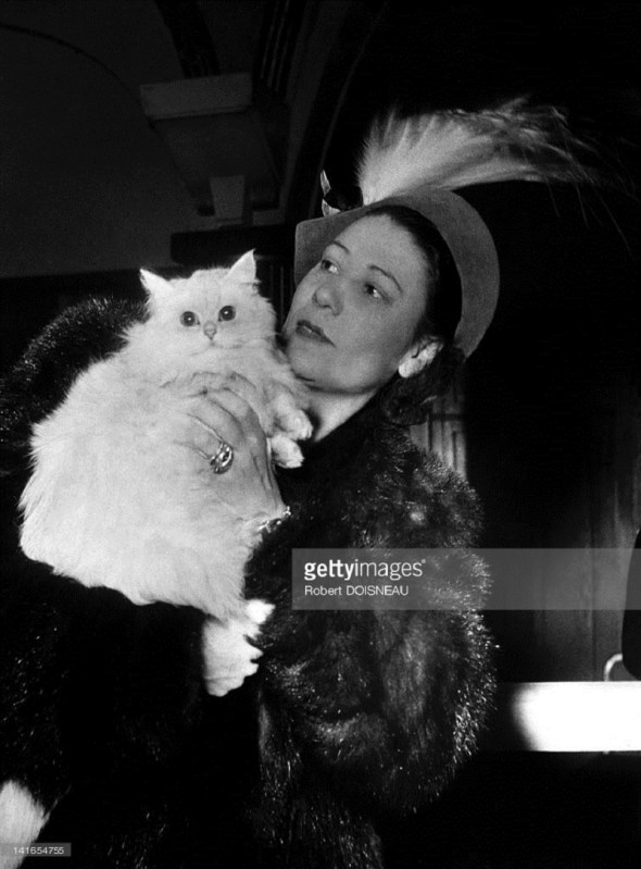 A woman carrying a cat during a 'Beautiful Cat Contest' held in 1946 Robert Doisneau