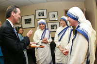 President of Benedictine College Stephen D. Minnis visits with the Missionaries of Charity in the new Mother Teresa Nursing Center.