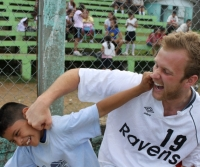 A Benedictine 'Raven' soccer missionary.