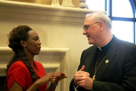 Immaculee Iligabiza chats with Kansas City-Kansas Archbishop Joseph Naumaan before her Sept. 11 talk.