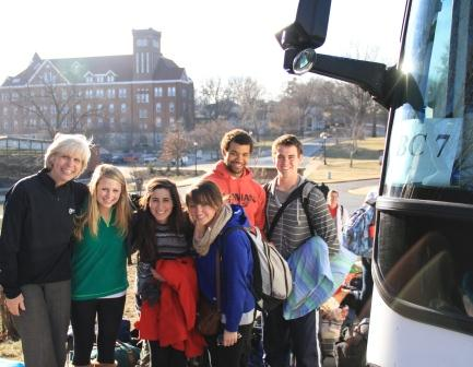 Vice President of Student Life, Linda Henry, boarding Bus 7 for the 60-hour trip.