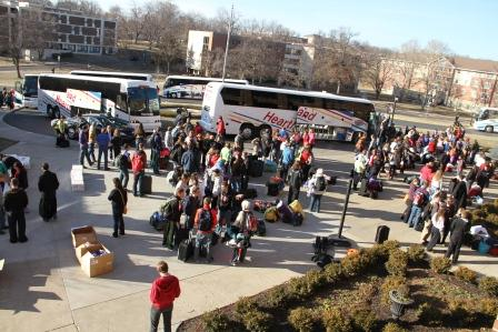 Students gather in front of the Haverty Center to go to meet the seven busses headed to Washington, D.C.