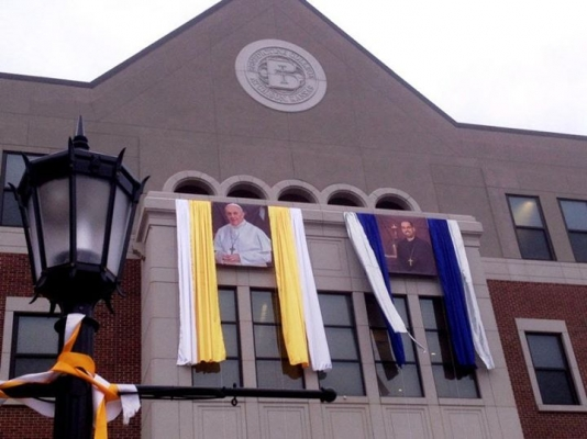 March 17 and March 19: For weeks, campus decorations celebrated new Pope Francis and new Abbot James Albers.